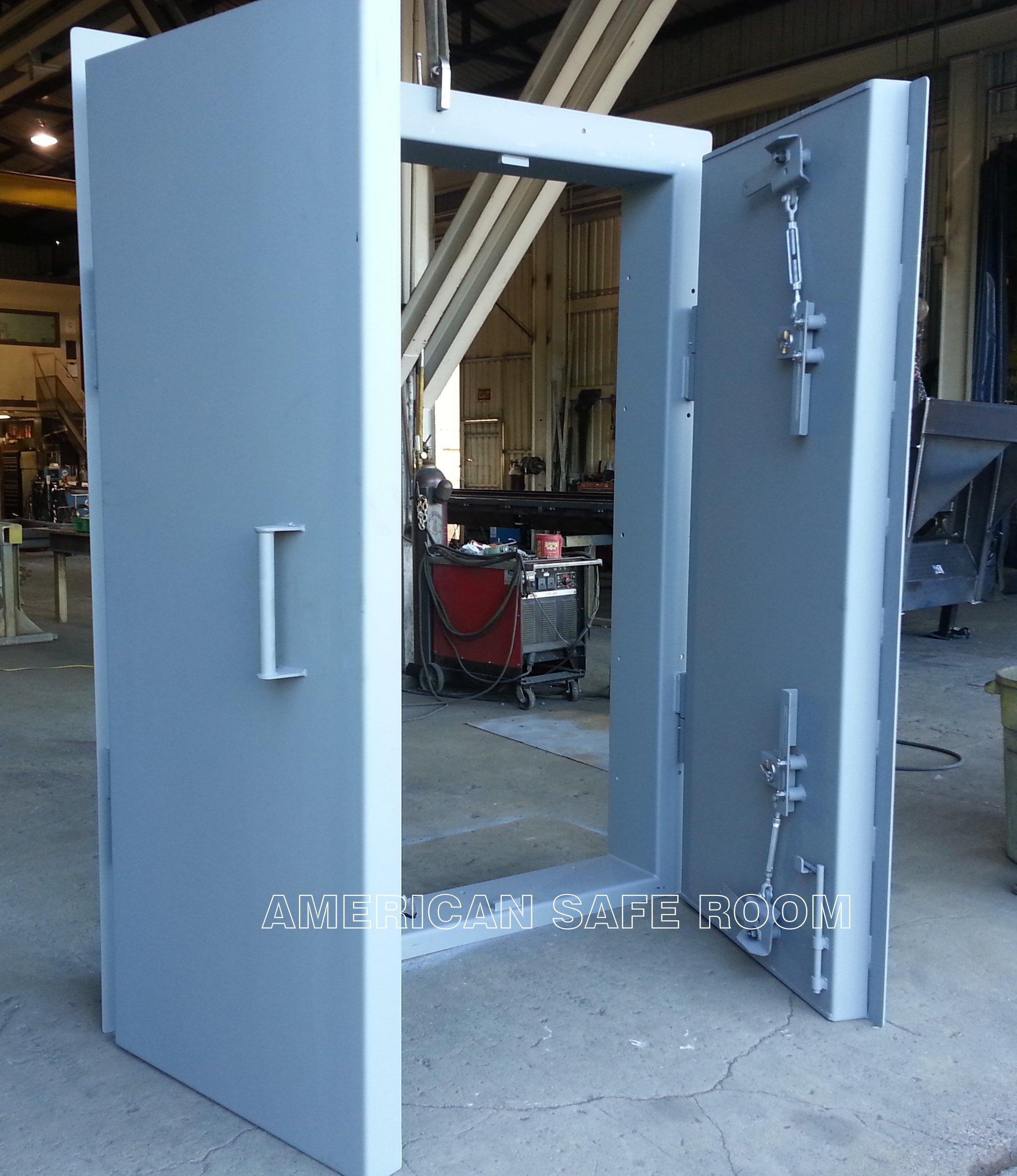 A double leaf ballistic door for the gun room at a private safari ranch & Custom blast and missile resistant doors pezcame.com